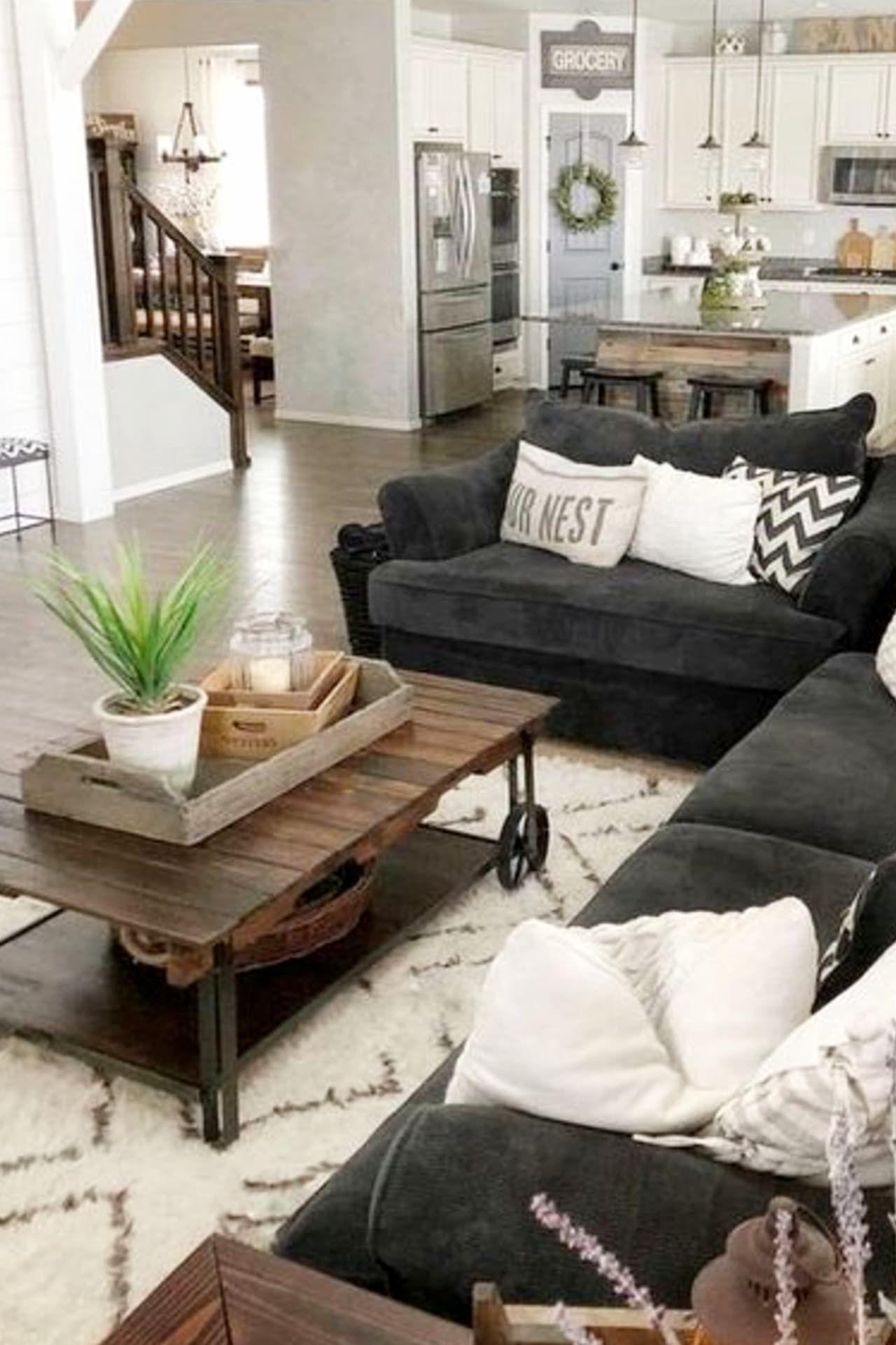 neutral gray farmhouse living room / den in an open floorplan layout design